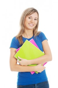 Young happy and satisfied student holding workbook.